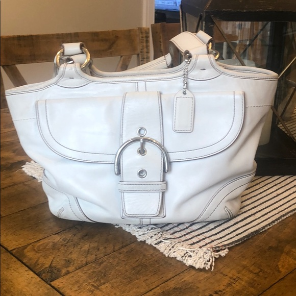 Coach leather hobo bag ivory with silver buckle.